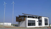energy positive office building with pv cells and wind turbine